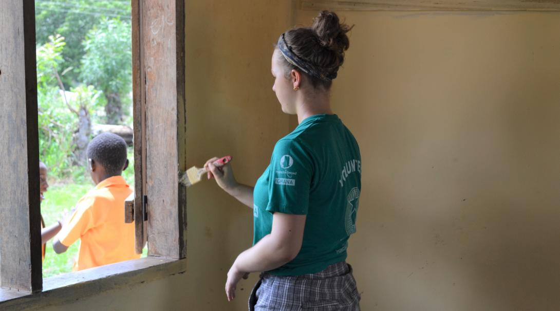 A high school student renovates a local school in Ghana during her community volunteer work for teenagers.